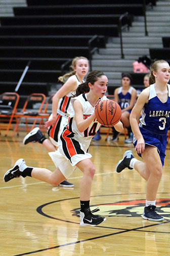 Dribbling down the court, Lauren Bossenberger out runs the opponent. The girls fought hard at their game against Lakeland high school. The girls next home game is tonight, December 7 at 5:30pm vs. Swartz creek.