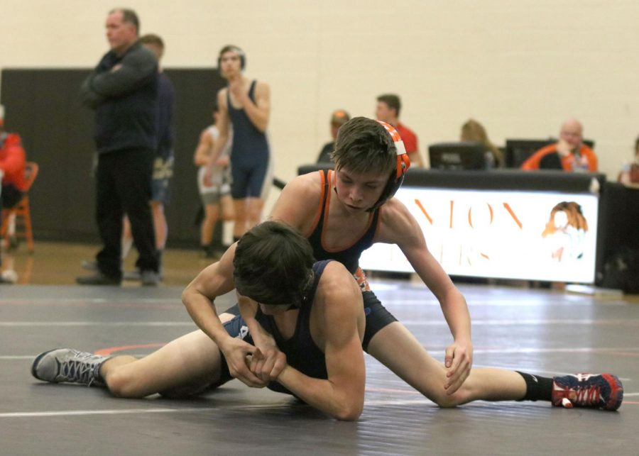 Freshman Luke Thorton wrestles his opponent with intent to win.  Luke pins winning yet another match for his team.