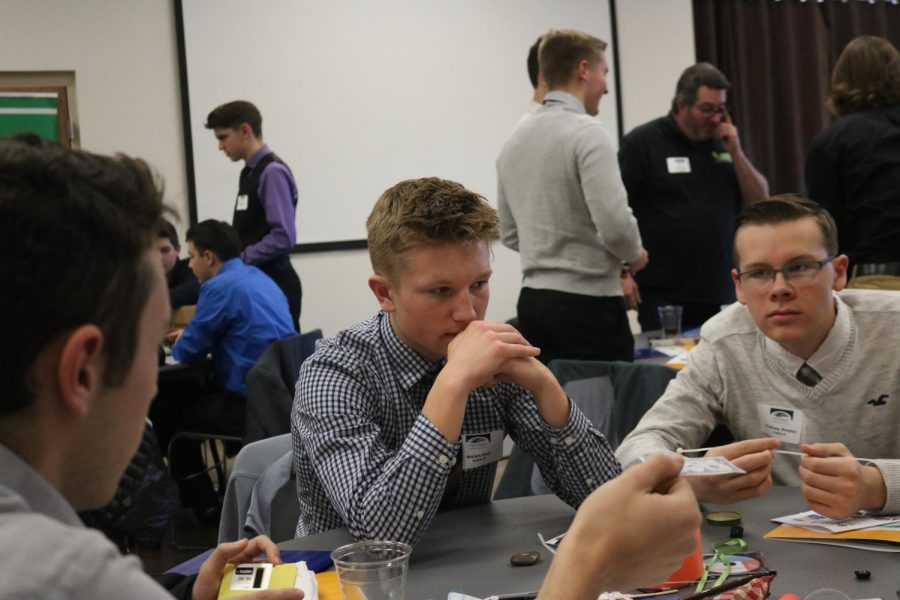 Junior Nolan Day attends boys in business along with other Fenton, Lake Fenton and Linden students to learn about important business and marketing skills that will help him in the future.