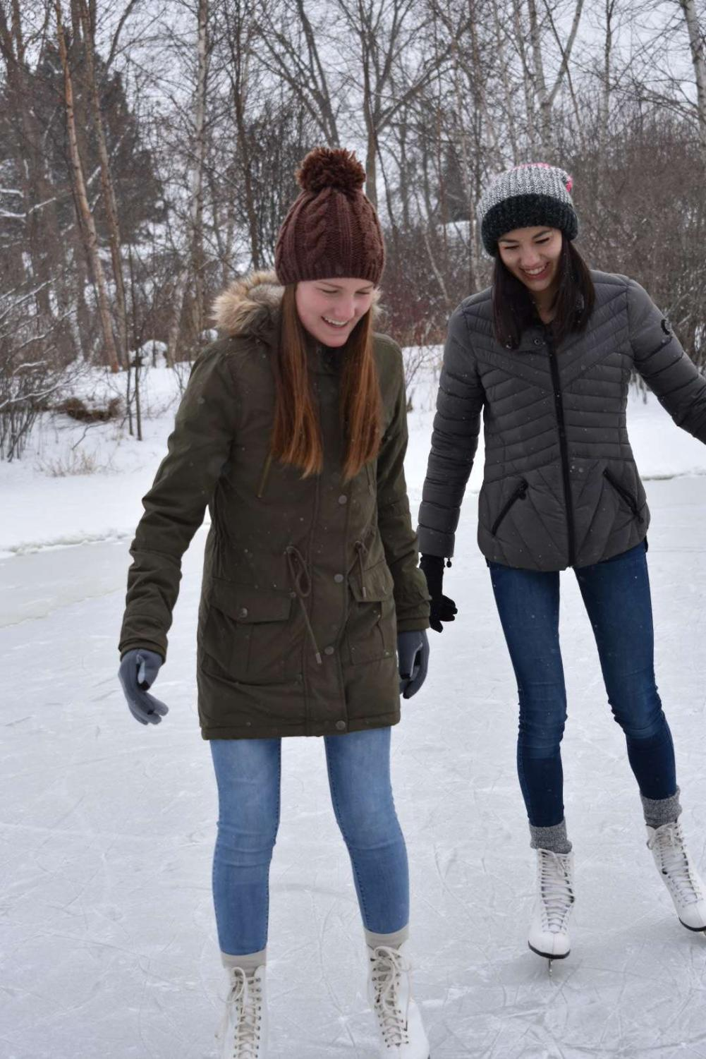 Despite the cold temperatures, sophomores Brooke Thomas and Cassie North venture out for an afternoon of ice skating.