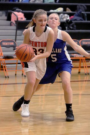 Running down the court, sophomore Brie Sanford steals the ball from the opponent. The girls JV basketball team played Lakeland High School on Tuesday Dec. 5.