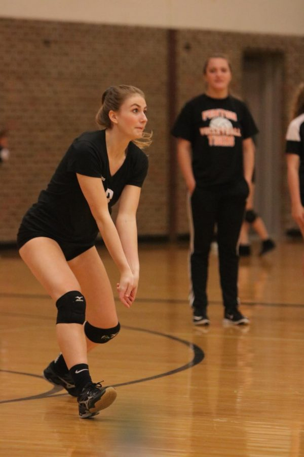 Going for the ball, junior Chloe McKenzie keeps her eye on the court ahead of her.