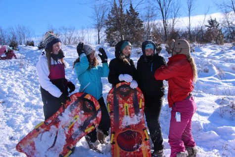 To commemorate the snow day, sophomores Julia Adams, Maria Ebert, Briel Sanford, Audrey Weir and Julia Young spent the day sledding with friends.