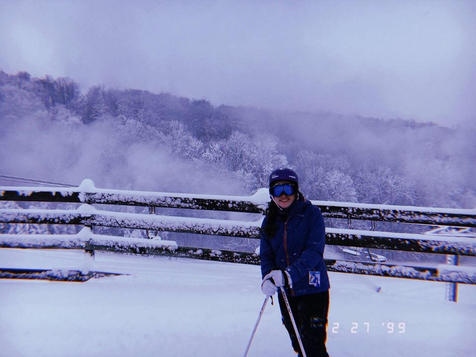 Freshman Kyla Lynch poses for a photo in between ski runs. Lynch along with her friends and family skied at Boyne Mountain during the winter break.