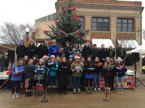 Varsity Vocals performs during the last weekend of the Holly Dickens Festival
