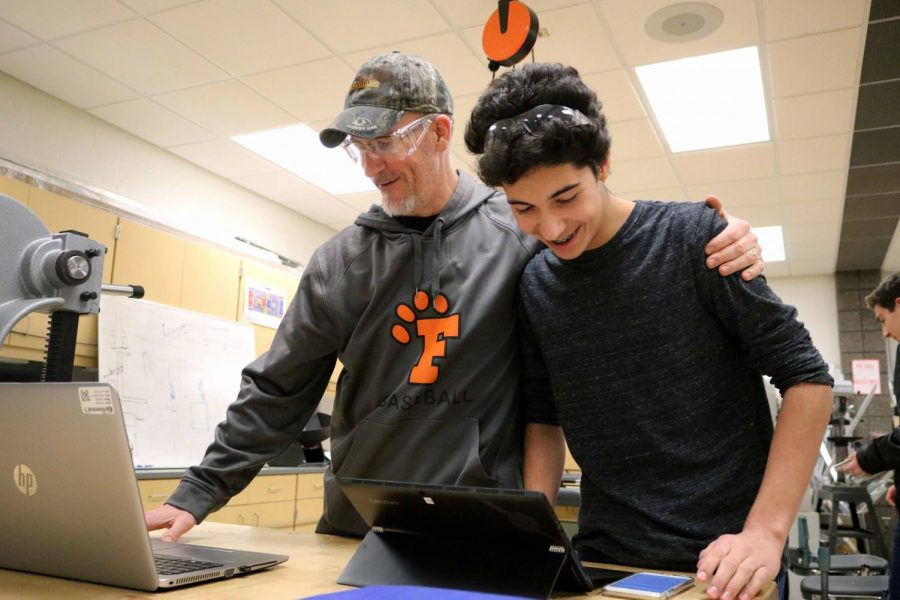 Sophomore Vaughn Doyle focuses on his computer reviewing the Robotics Team's new project. Doyle was researching on how to construct the project and what materials to use. The Fenton Titanium Tigers next competition is on Mar. 2. at Kettering University.