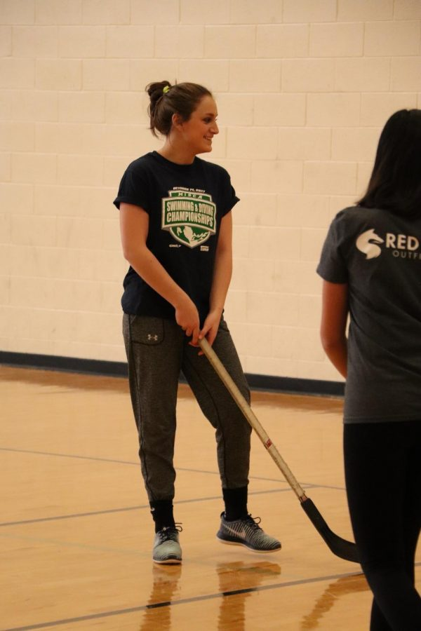 Focusing on the game, freshman Abby Dolliver plays floor hockey in her Physical Education class. Students are learning the rules and scoring of floor hockey.