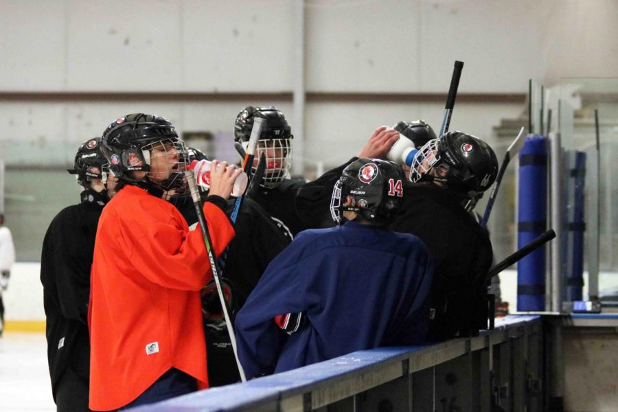 During practice on Jan. 4, the Griffins Hockey Team take a water break at Hartland sports center. their current record is 7-9 and their next game is on Jan. 27.