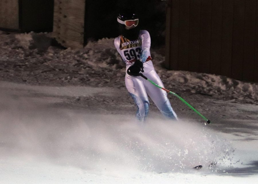 Senior Annie Koester skis in her giant slalom race against Holly/Oxford in hopes to improve her time.