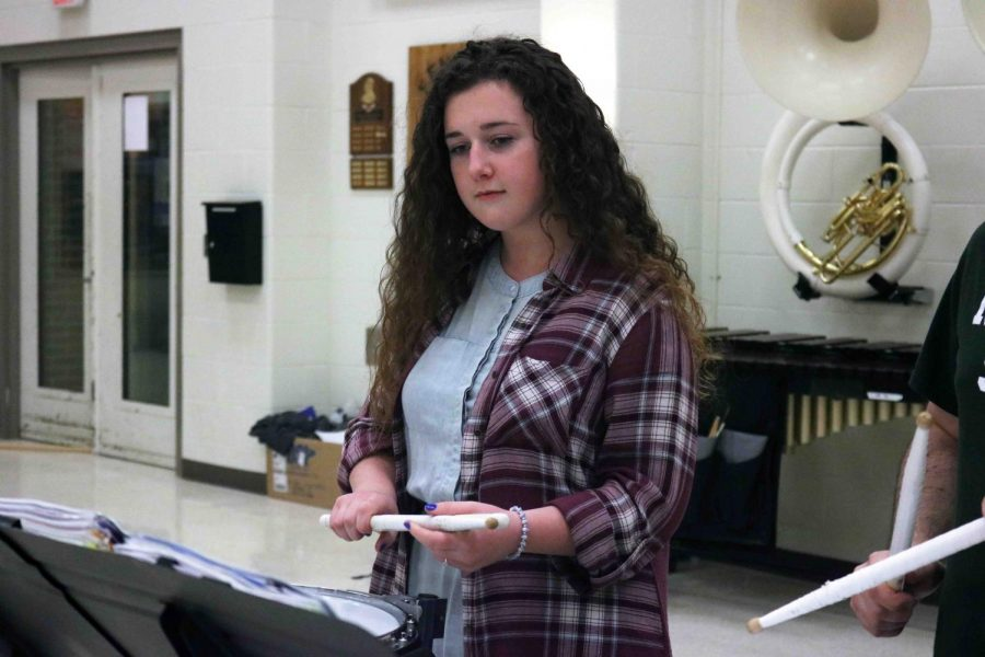 Sophomore Jenna Maher practices at her drum lesson to improve her playing or drum line. Drum line in the marching band and winter drum line performs at the boys basketball games. Their next performance is Tuesday Jan. 23.