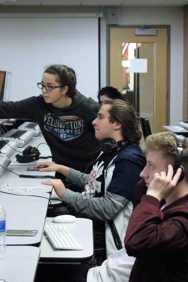 IB theater students research their charters and set designs to prepare for their next play The Laramie Project. The play is about the reaction to the murder of a gay student at the University of Wyoming in Laramie, Wyoming.