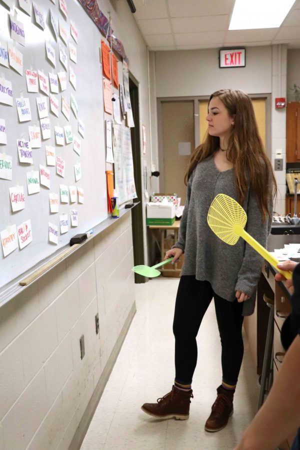 Senior, Annie Koester examines the options while next to her opponent. The anatomy classes review for their exam by playing a fly swatter game. The class divided into two teams and went against each other rapidly answering questions. Whichever side of the room got the most answers correct get extra credit.