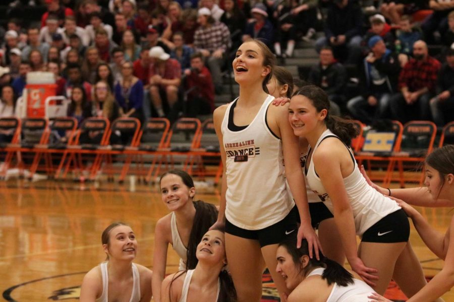 Ending+their+first+performance+during+halftime+at+the+Fenton+varsity++basketball+game+against+Linden+freshman+Taylor+Farrell+poses.+The+Dance+team+had+been+working+hard+and+preparing+for+their+fist+of+many+performance.
