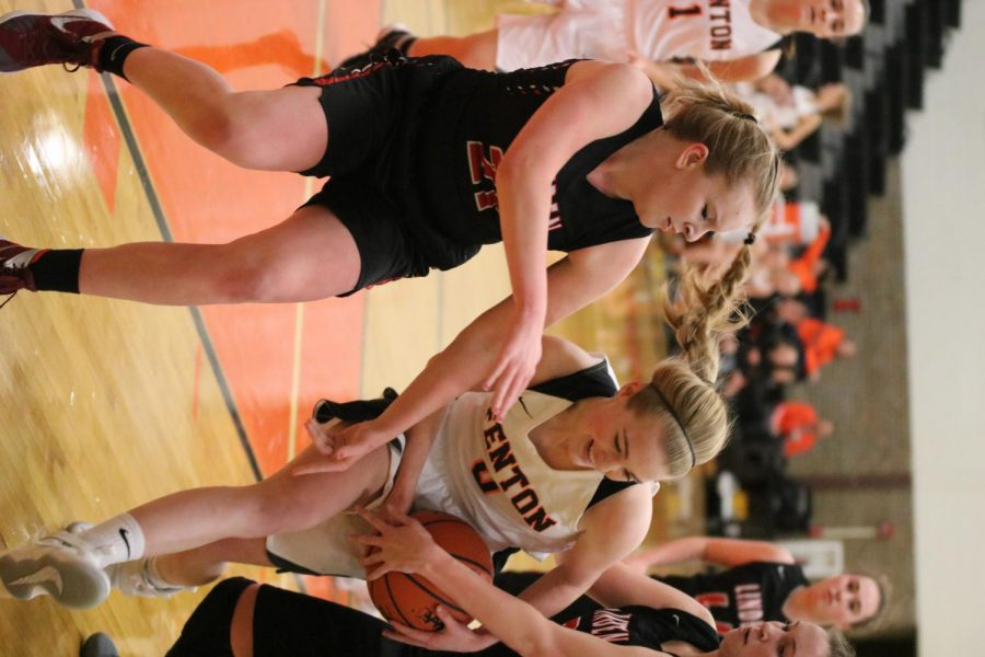 Fighting for the ball, junior Lauren Murphy plays against Fentons rivalery team, Linden. The gils pulled out an outstanding win against the Eagles with a score of 67-32.