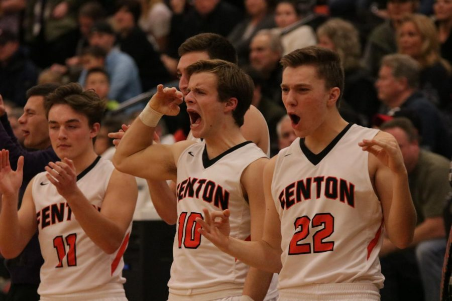 Following a play, junior Logan Welch and senior Edward Farrell show much emotion. The Varsity boys team played against Linden. The game resulted in a win for the Tigers with a final score of 36 - 35.