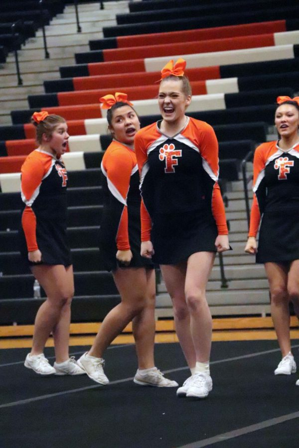 In their first invitational competition, senior Madison Dotson competes alongside her competitive cheer team. The girls went against schools from all around the county and earned themselves second place.