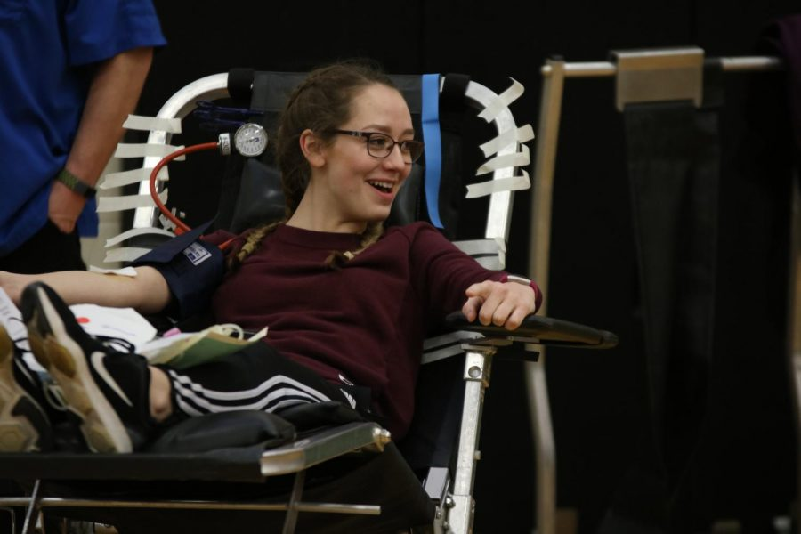 Junior Amelia West donates blood during first hour on January 17th. From her giving one pint of blood she could save up to three lives.
