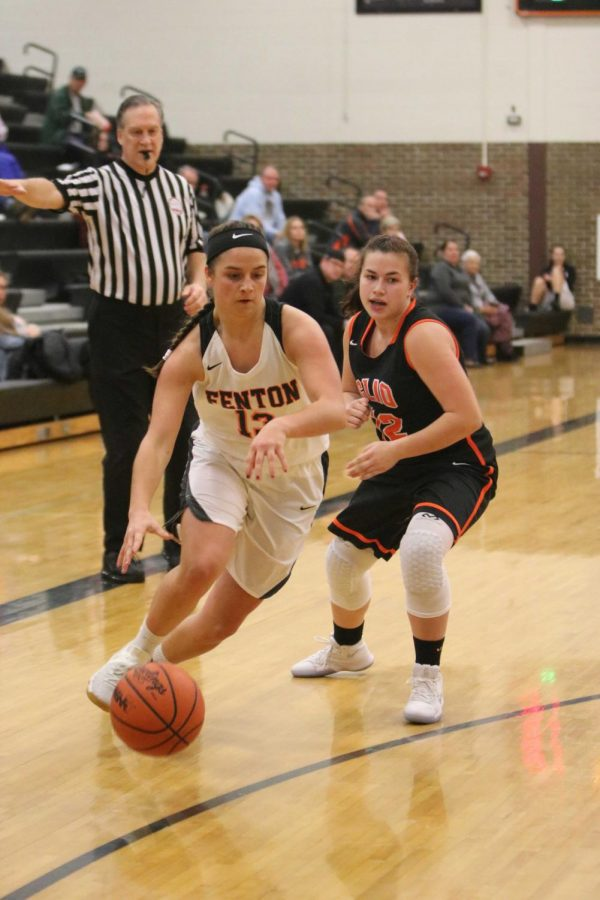 Senior, Aly Lenz, defends the ball from her Clio opponent. The varsity players finished their game against Clio with a win, 63-45 on Dec. 19.