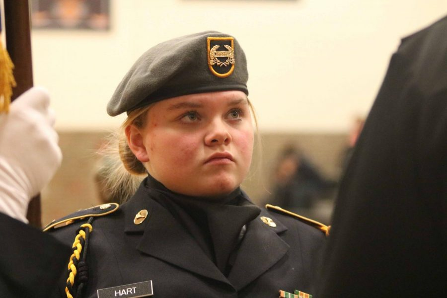 Junior Taylor Hart listens to her Commander for directions as the Flag Ceremony is about to start. On Dec. 22, during SRT the Jazz band and the Ambassadors were performing their holiday songs to Fenton High.