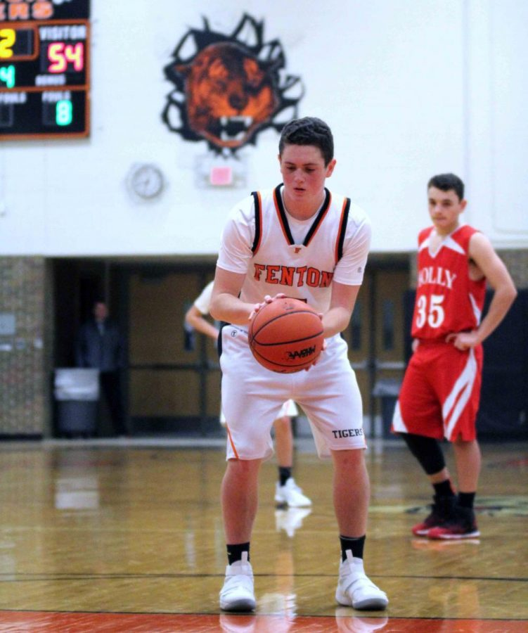 Freshman Dylan Davidson has his eyes on the ball as he gets ready to shoot a three pointer. On Thursday, January 4th, the Freshman boys basketball team won 58 to 54 over Holly.