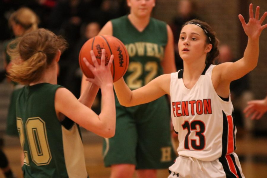Freshman Maggie Lutz stops number 20 on the Howell team. When number 20 tried to pass the ball Lutz grabbed it and got the point for Fenton High.