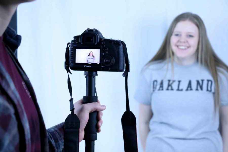 Lillian Pugh is smiling for the camera as they film a commercial for the Virtual Enterprise (VEI) class. On Monday, January 8th VEI filmed a commercial to create their company, Waybound, Inc.