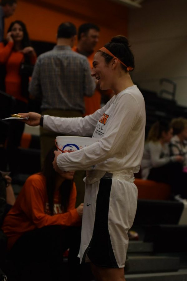 Getting donations at the Holly vs Fenton for Kyle Gauer, Senior Margaret Berry going in the bleachers to take donations and give out candy. All JV and varsity girls from basketball team helped out in the bleachers.
