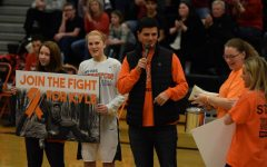 Boys and girls varsity basketball programs host fundraiser for Kyle Gauer