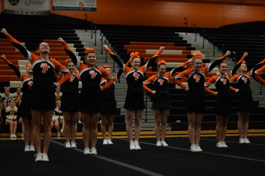 Competing+at+home+on+Feb.+16%2C+the+girls+varsity+competitive+cheer+team+participate+in+their+districts+meet.