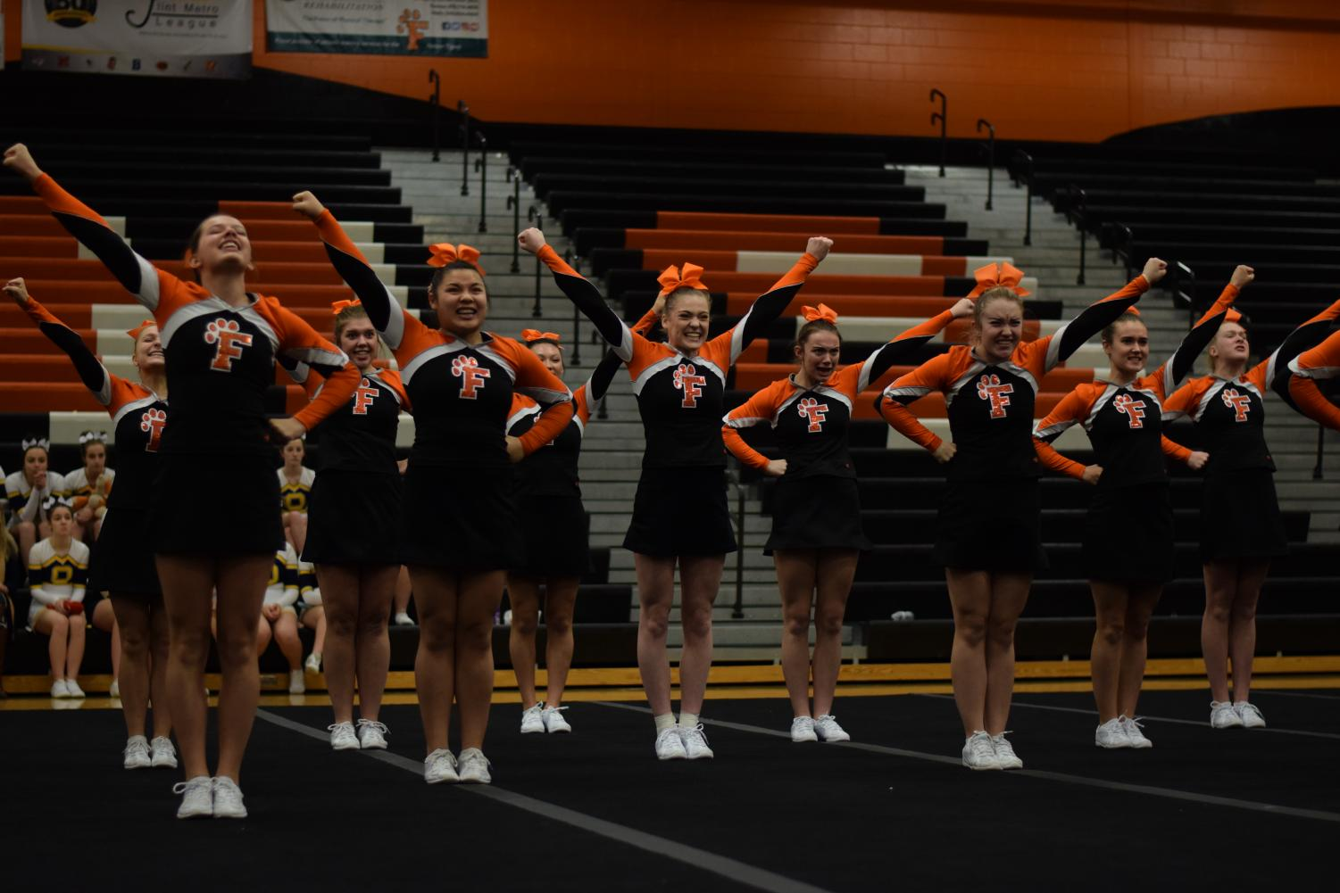 Competing at home on Feb. 16, the girls varsity competitive cheer team participate in their districts meet.