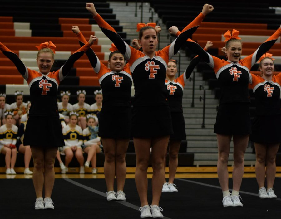 Freshman Taylor Wire strikes each move  in her routine with the rest of the varsity cheer team at the Homer Invitational. The team took home second place and compete next at home in the Tiger Invitational Feb 10.