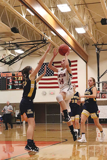 Going for a lay up, sophomore Lauren Bossenberger made 22 points for the tigers at their game against Owosso. She made five 3 pointers and the girls won 38 to 29.