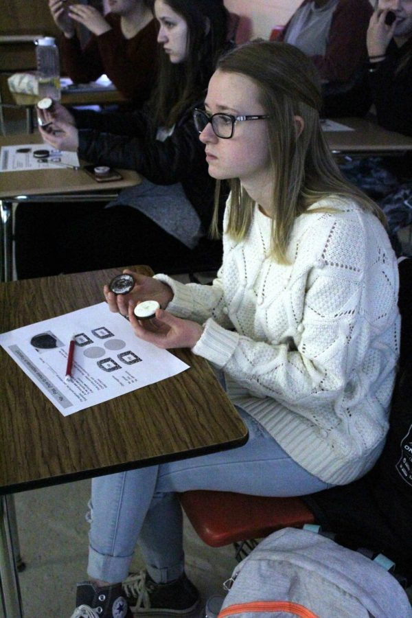 Separating her Oreo cookie into two halves senior Alyssa Golden participates in the French 1 game. On Friday, Feb. 2 Mrs. Nickole Smelis taught her class how to pronounce words using Oreos.