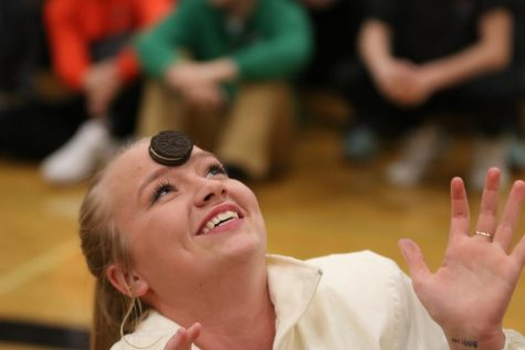 In hopes of winning the event, senior Molly Gundry attempts to get an Oreo into her mouth. The sophomores ended up winning the winter pep assembly and received the spirit stick.