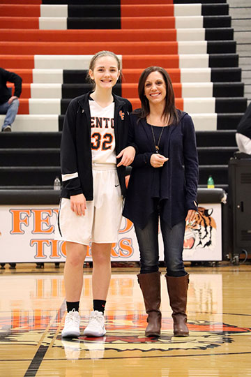 Thanking her mom for all the support, sophomore Brie Sanford walks with her mom. The girls basketball teams honored their parents at the end of their game.