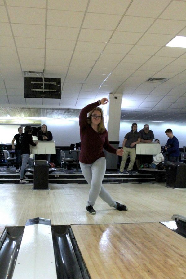 As somphmore Zoe Simmerman rolls her ball down the lane she watches as it nocks all ten pins down. Simmerman has beaten a personal record for the season. she along with the the Bowling Team compete next on Feb. 16 at Colonial Lanes in Flushing.