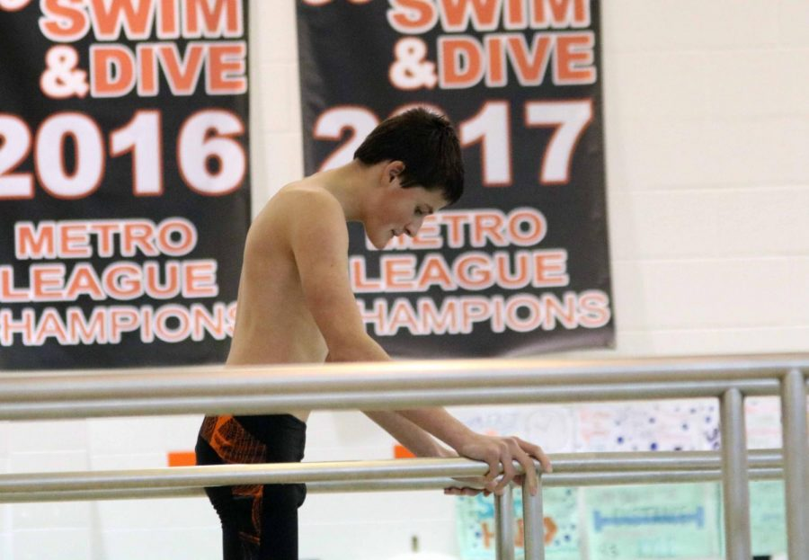 Sophomore, Jack Killian prepares himself for his next dive. County's took place on Saturday, January 20th, the boys swim team placed in many meets.