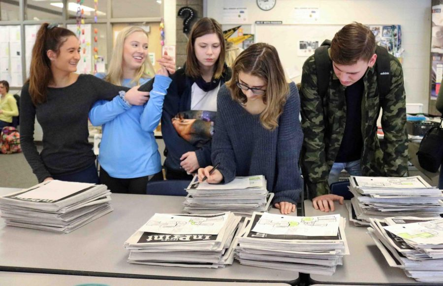 Members of the newspaper staff organize stacks of newspapers to be distributed out to all of the SRT classes. The next issues of the paper is scheduled to come out March 22.