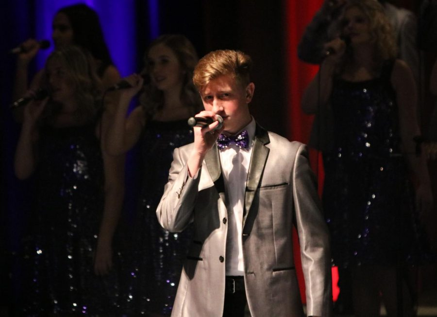 Junior Joe Bujak sings in the beginning of the Ambasadors concert on Feb. 23. This is Bujaks third year on Ambassadors.