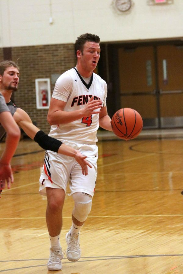 Senior David Pietryga runs the basketball down the court during the Clio game on Jan. 30.  They won the game 54-44.