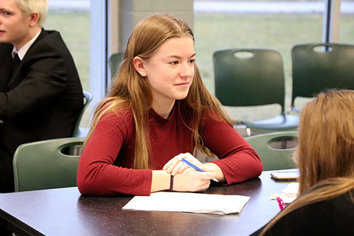 During the IB history speed dating, junior Maddie Hayden talks to several different students about her historical figure. Each student in the class was assigned a person to dress up as and talk about them.