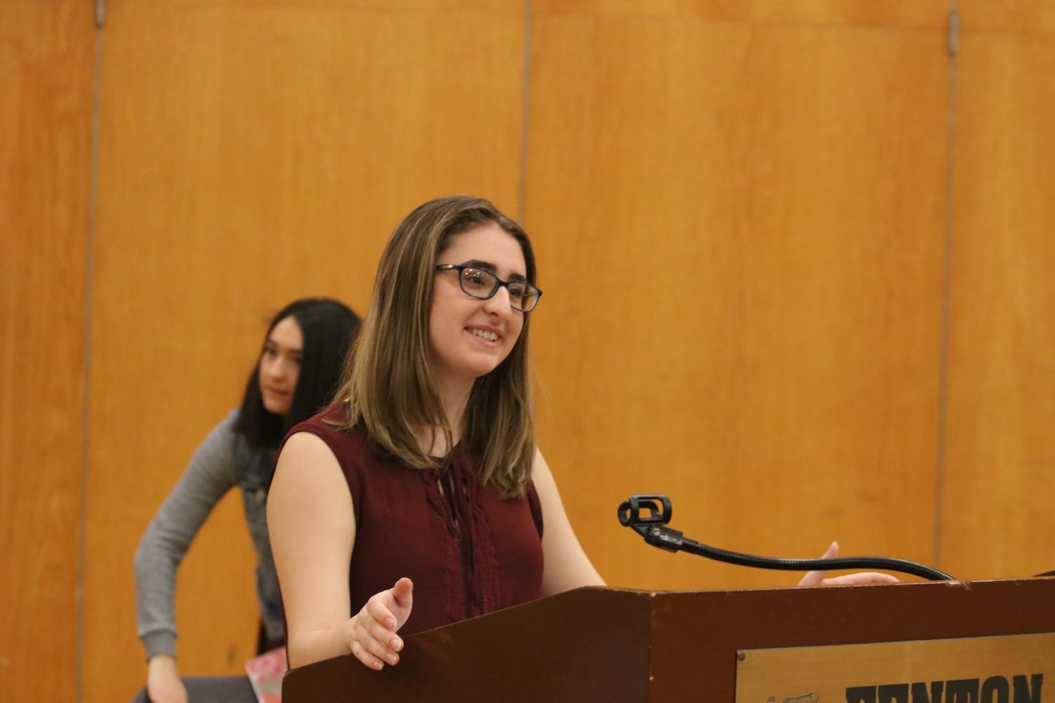 Honoring victims of gun violence, junior Ellie Bennett and other students gathered in the gym for the Parkland Memorial Ceremony on March 14.
