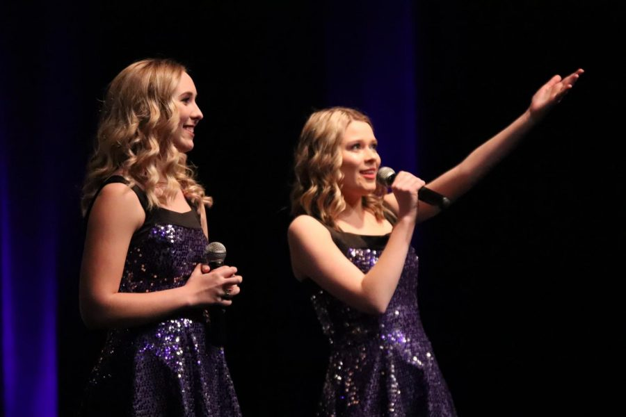 Seniors Lauren Bedell and Kelly Canning introduce themselves to the audience as the only two, four year seniors on the ambassadors.