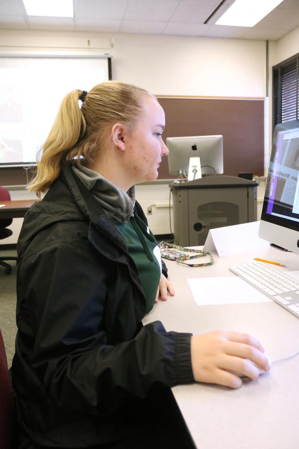 Freshman Catherine Haynes learns InDesign as preparation to be business manager. Newspaper and yearbook students went to a one day MIPA workshop to learn about InDesign and photoshop.