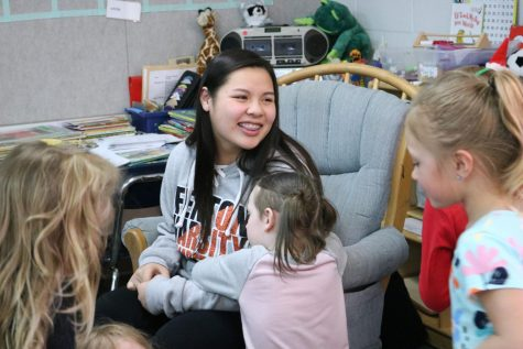 Sophomore Lillian Huynh talks to elementary school students before reading to them. On March 26, Key Club members went to Tomek-Eastern Elementary to read to students for March Reading Month.