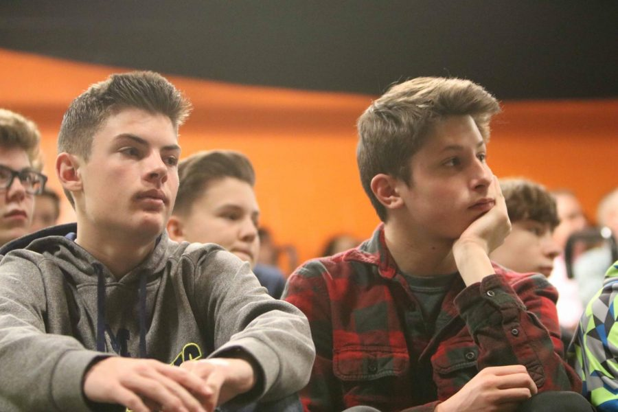 Freshmen Hunter Wheeler and Gage Bond give their undivided attention to David Leyton, the Genesee County prosecutor.  Leyton came to the school to give students a presentation about school shootings during SRT on March 28.