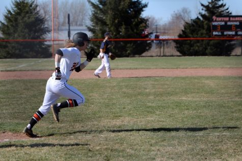 Running to first base, senior Logan Benson plays on Friday night vs Goodrich. The team played hard and won their second game against Goodrich.