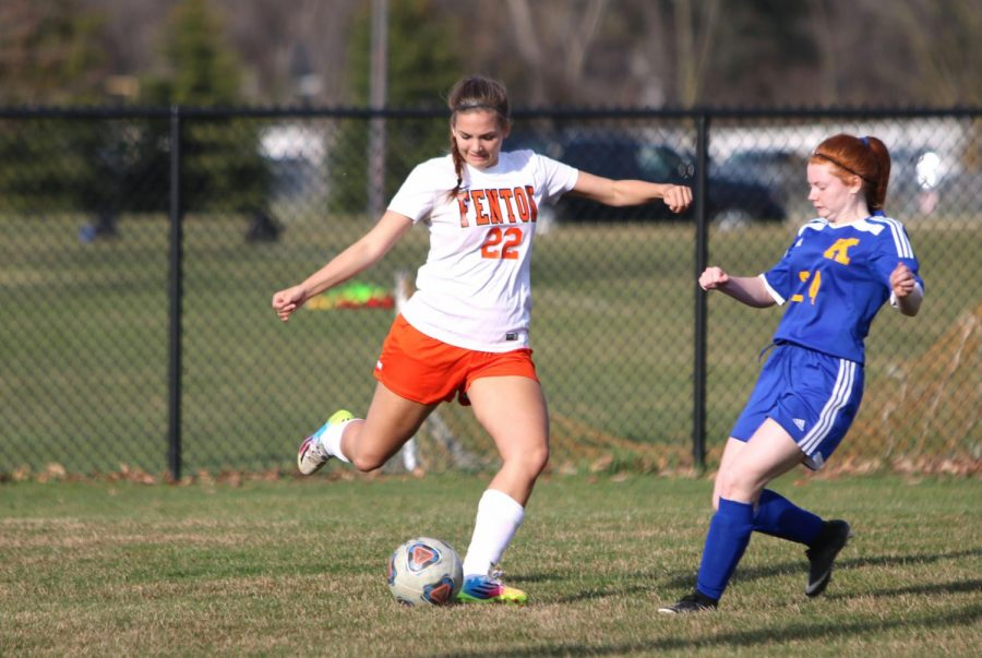 Senior Annie Koester prepares to make a pass to another teammate on Apr. 23. The varsity girls soccer team played Kearsley at home.