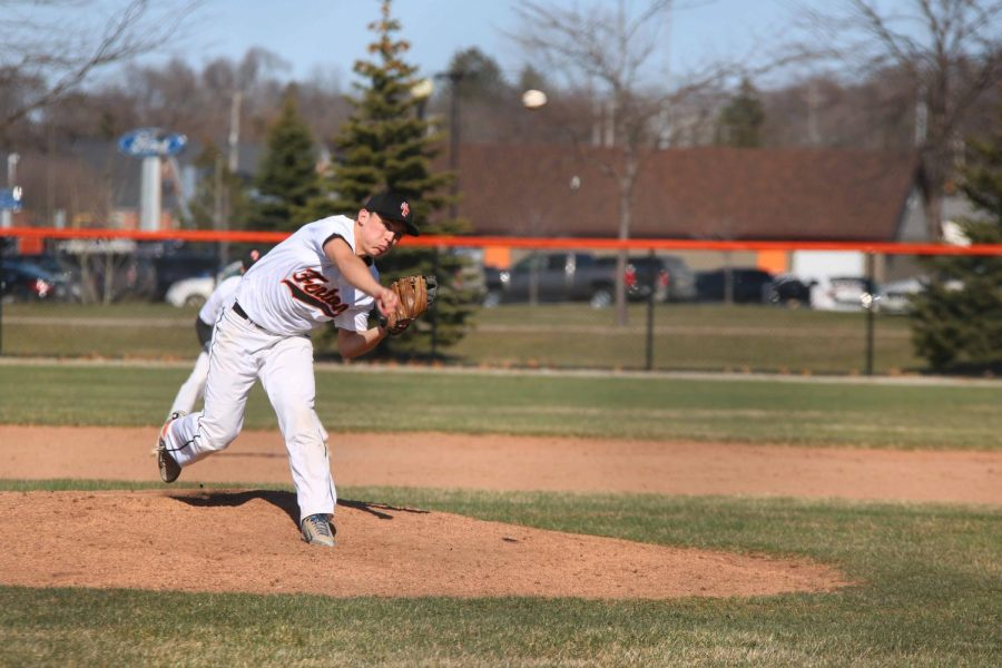 Junior Brock Henson pitches the ball during Friday's varsity baseball game against Goodrich. They won 4-3.