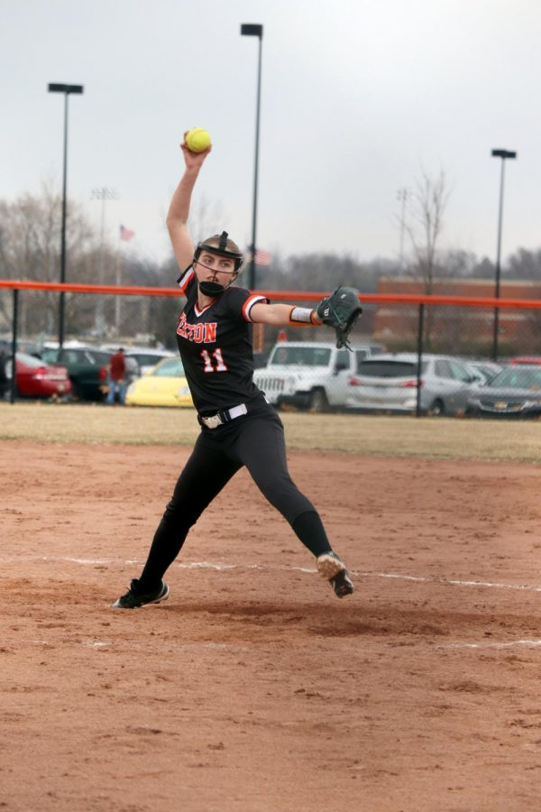 Leaping forward, Freshman Katelyn Beverly pitches the ball. The JV softball team won their first game 14-3.